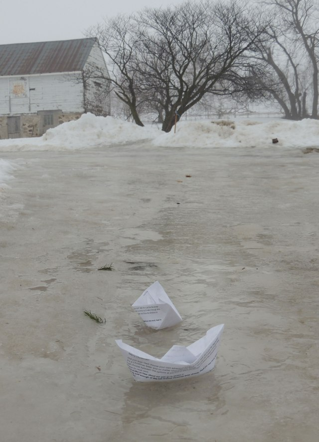 Paper boats on driveway