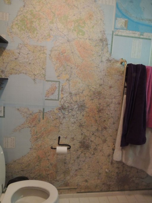 I have no idea how to get a picture of a bathroom. It's your basic bathroom, toilet, shower, sink and lots of maps.