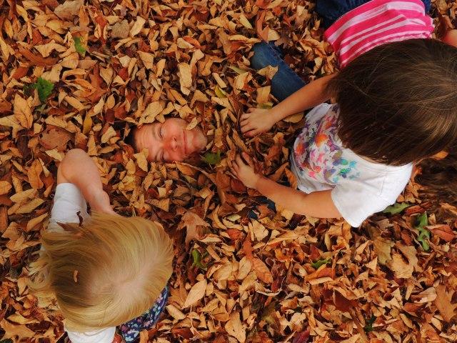 John in leaf pile