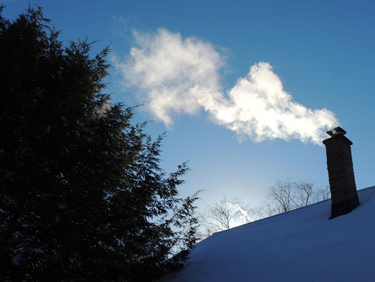 winter sky and chimney smoke