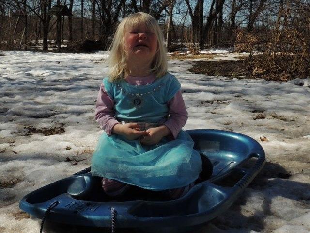 Jane crying on sled