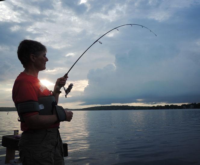 One armed carp fisherwoman