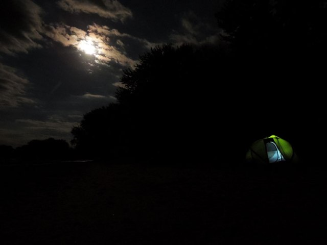 river campsite under full moon