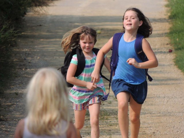 Ivy and Clara running up driveway