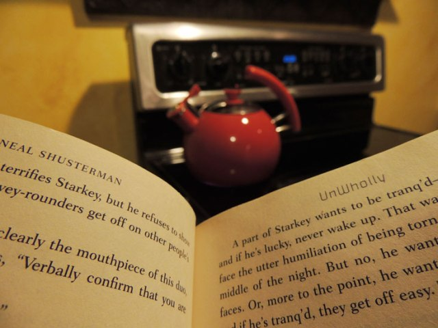 reading a book while waiting for water to boil