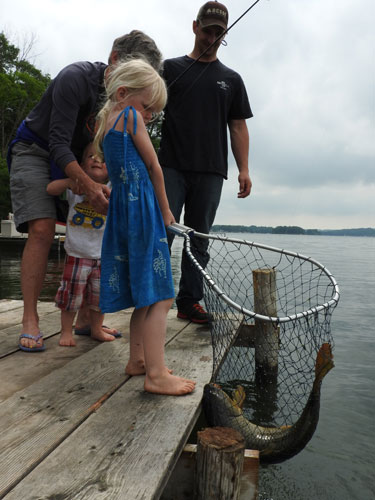 Jane, Jonas, Grandma Mary and Tyler catch a carp together
