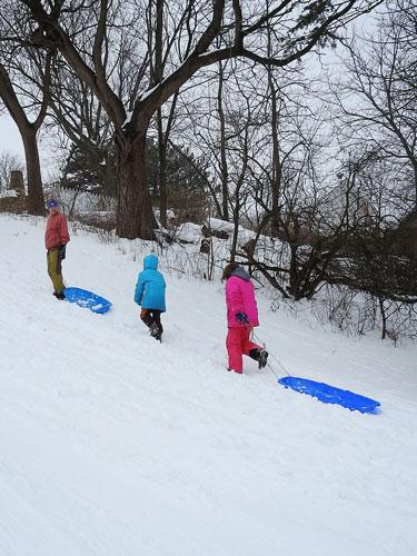 Grandma Mary, Clara and Ivy sledding