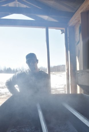 Tyler in the steam of the sugar shack